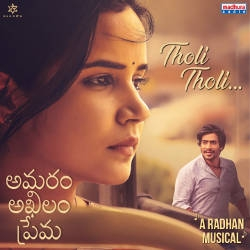 Listen to Tholi Tholi songs from Amaram Akhilam Prema
